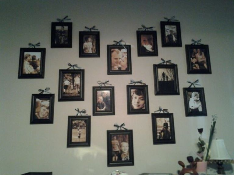 My photo wall made from Walmart frames, some brown and blue ribbon ...