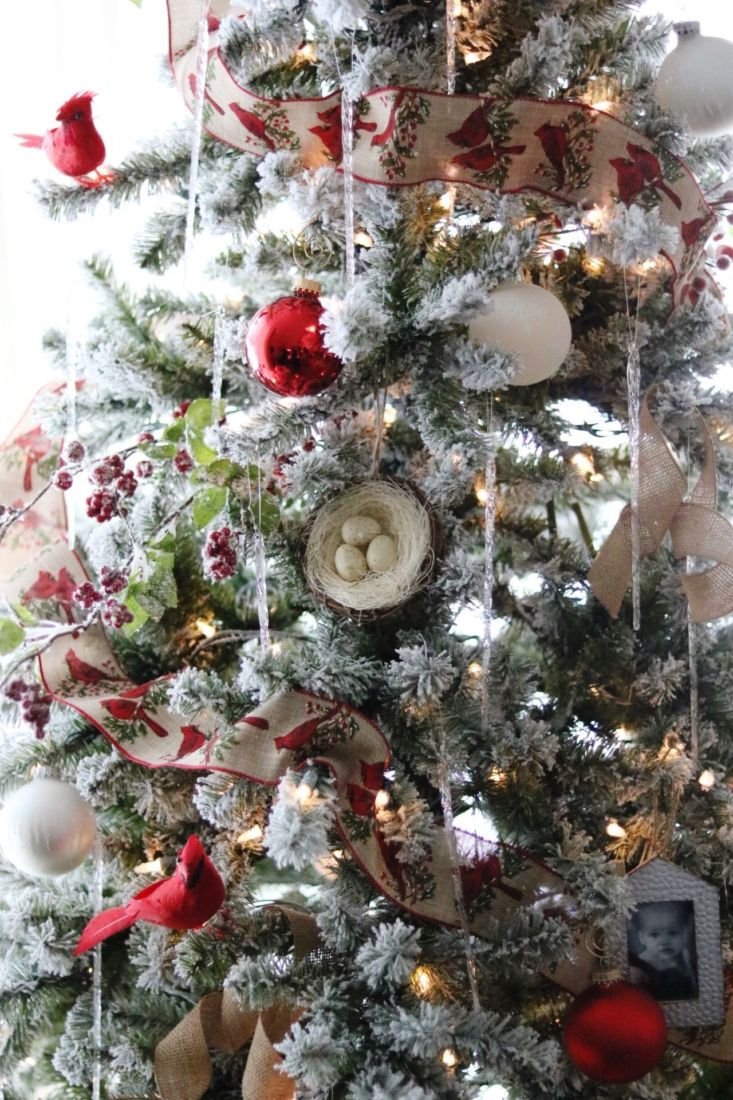 7.5 foot flocked tree from Menards decorated with cardinals, icecles ...