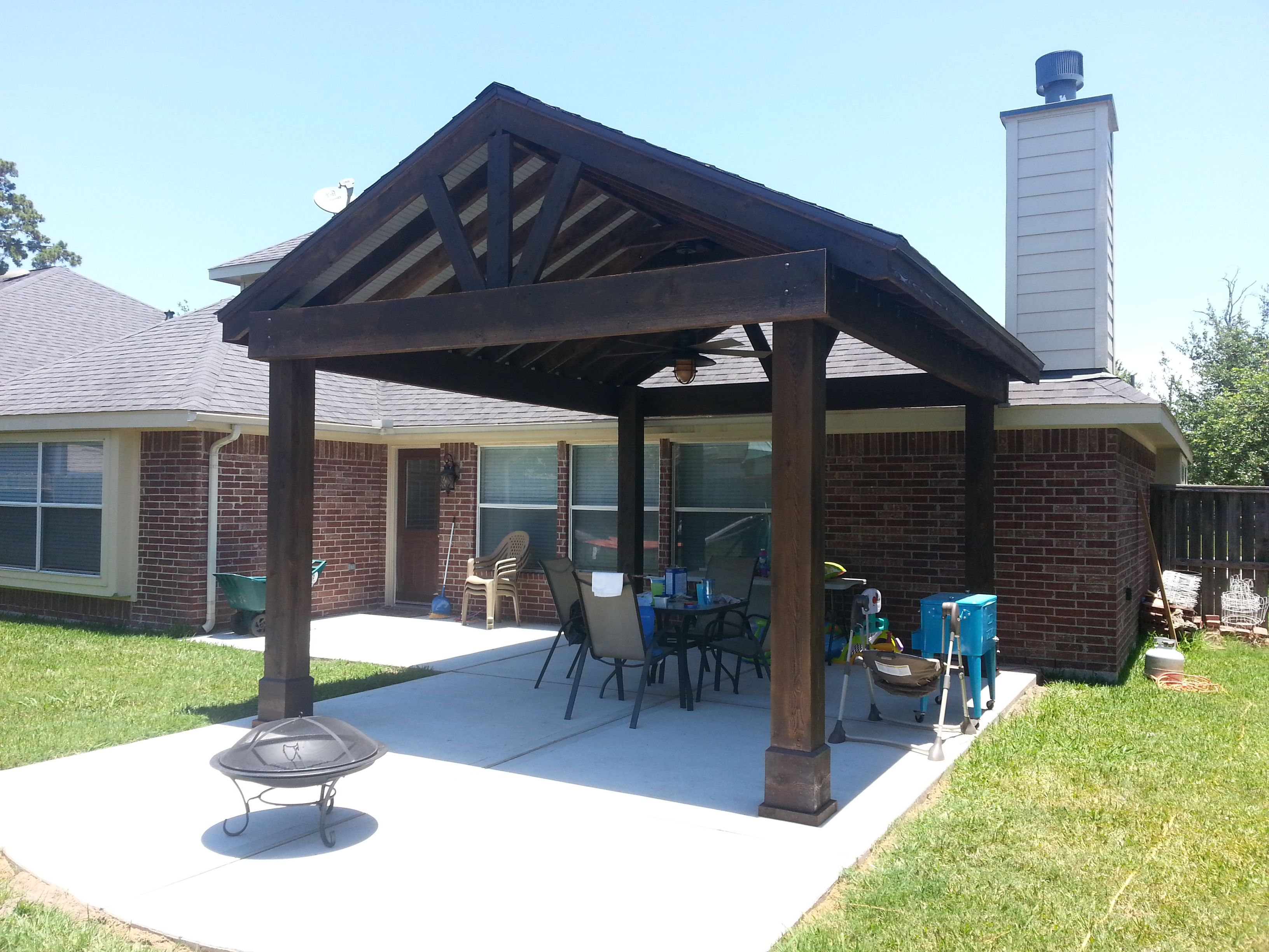 beautiful free standing stained wood gable patio cover