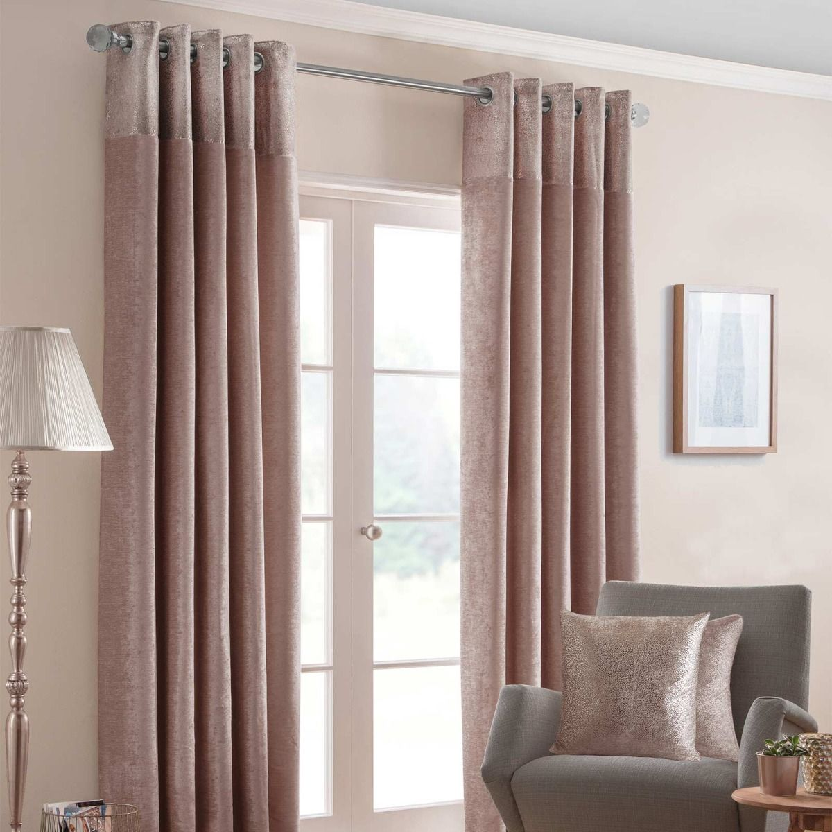 <p>Contemporary blush pink eyelet curtain pair in a chenille style fabric and foil banded top header for a glamourous look inside homes while blocking out sunlight.</p> <p><strong>Pink Eyelet Curtains</strong></p> <p>Glamourous and soft, these subtle pink curtains are perfect for adding charm and sophistication to interiors. With a beautiful foil printed banner, this curtain pair will help transform living rooms. Perfect for blocking out sunlight and reducing draft, these curtains can also help