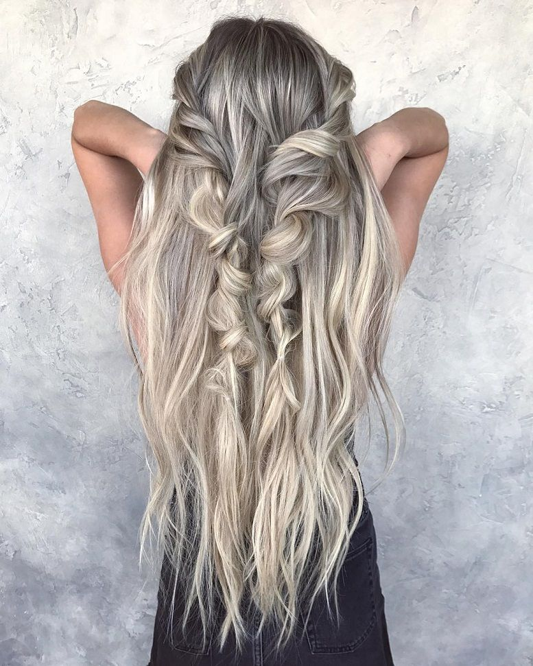 Messy braided half up half down hairstyle