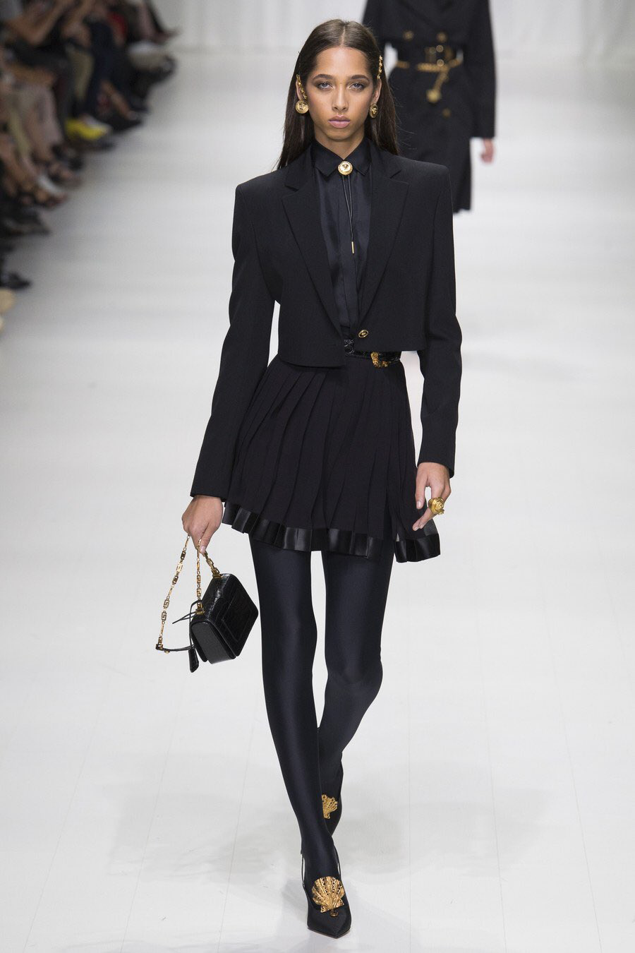 women's bolo tie / black suit / gold accents / black blazer / black skirt /  womens loafers / See the complete Versace Spring 2018 Ready-to-Wear  collection.