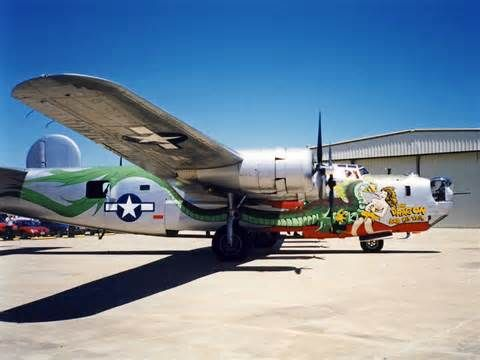 """B24J Consolidated Liberator bomber, """"The Dragon and His Tail"""", Tail #973."""