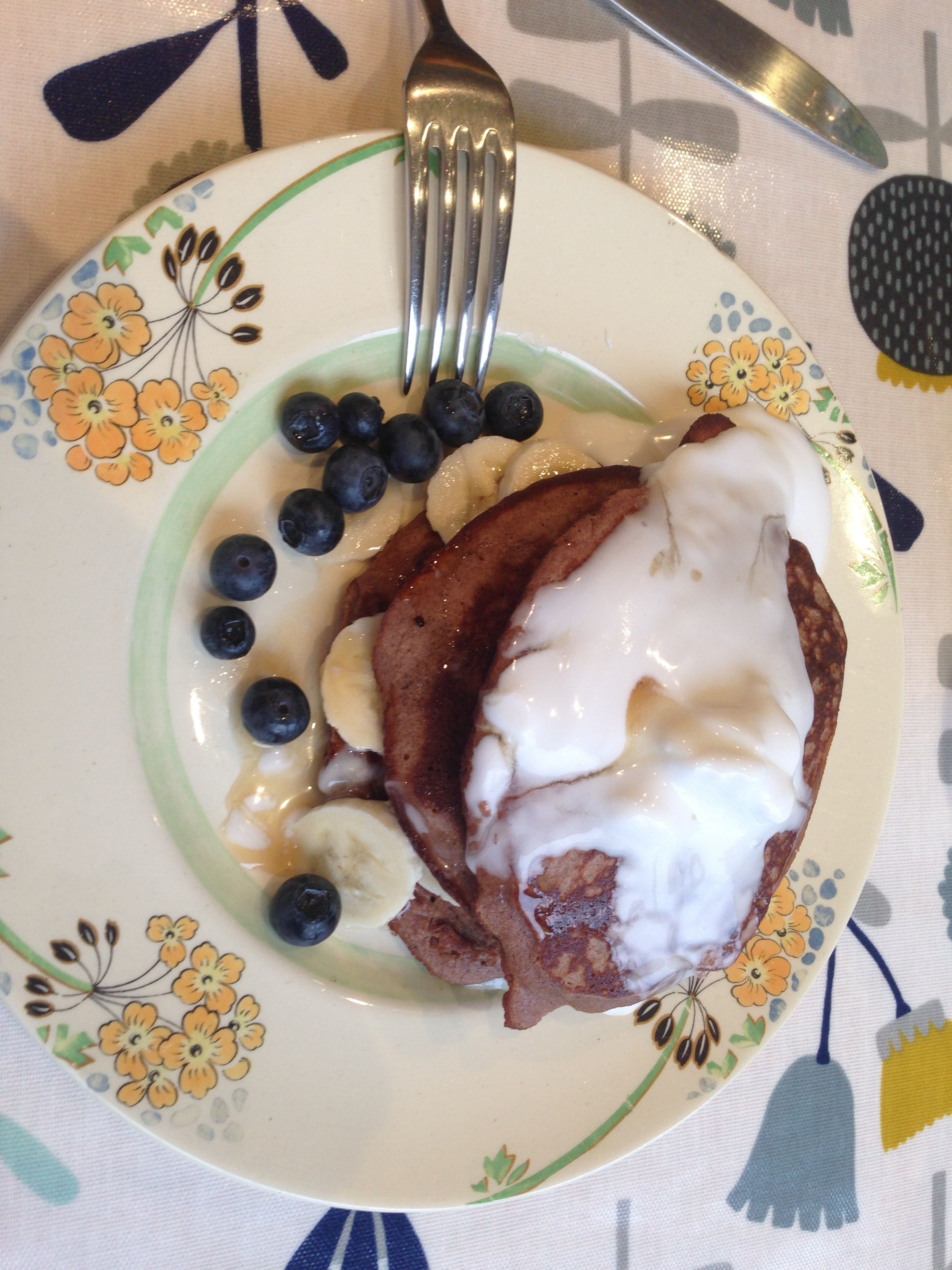 Chesnut flour pancakes with banana, blueberries, coconut yogurt and maple syrup .... yum.