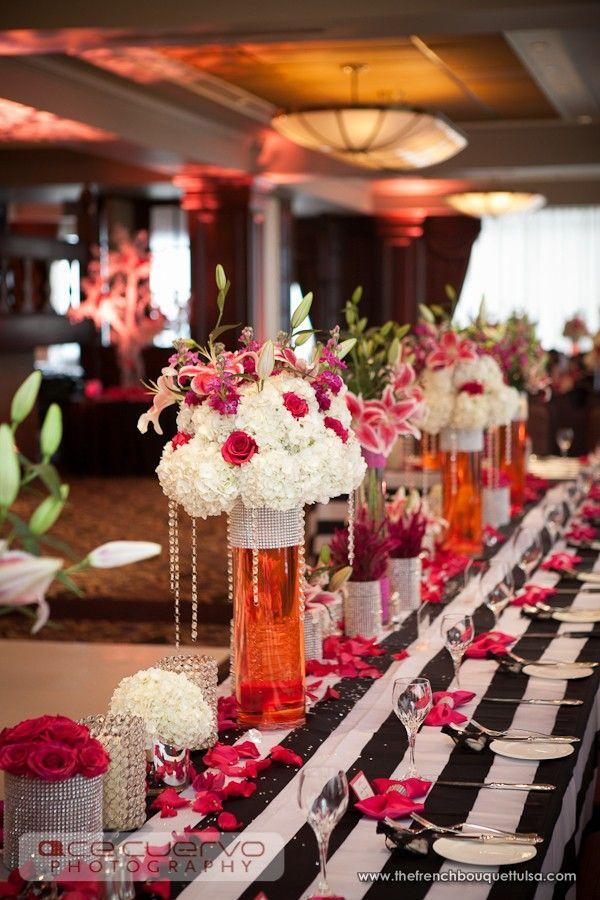 Pink And White Centerpieces With Pink Colored Water In Tall