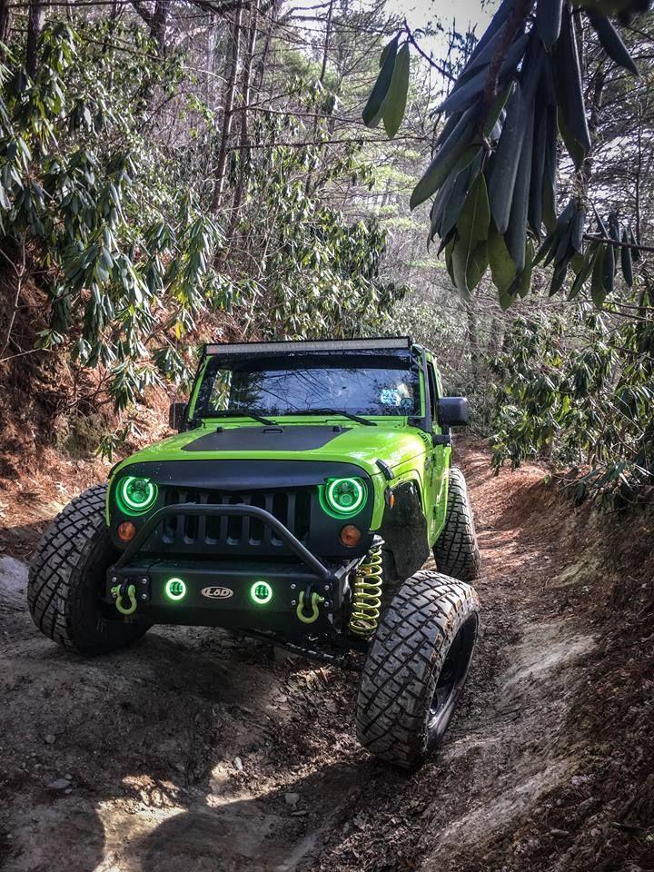 Green Halo Headlights And Fog Lights On A Green Jeep Wrangler Jk Rgb Led Combo With Bluetooth App And Handheld Jeep Lights Green Jeep Jeep Wrangler Headlights