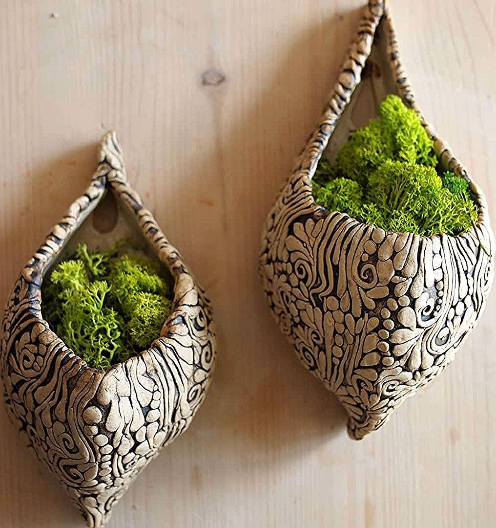 New, ornamented hanging flower pots. . . . #ceramics #ceramicdesign #pottery #potterydesign #ceramiclove #stoneware #ceramicart #flowerpot…
