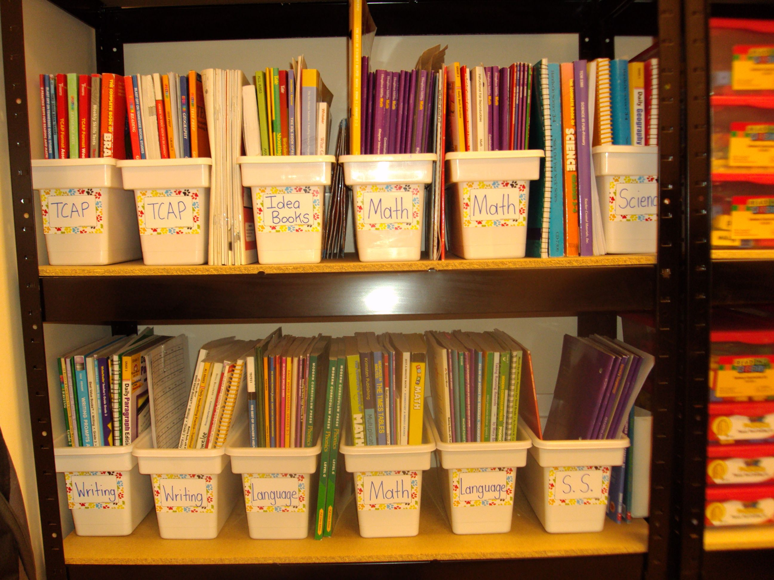 Wal-Mart ice bins for storage.  Great for book tubs! @Starla Harlow, I wonder how much these cost?