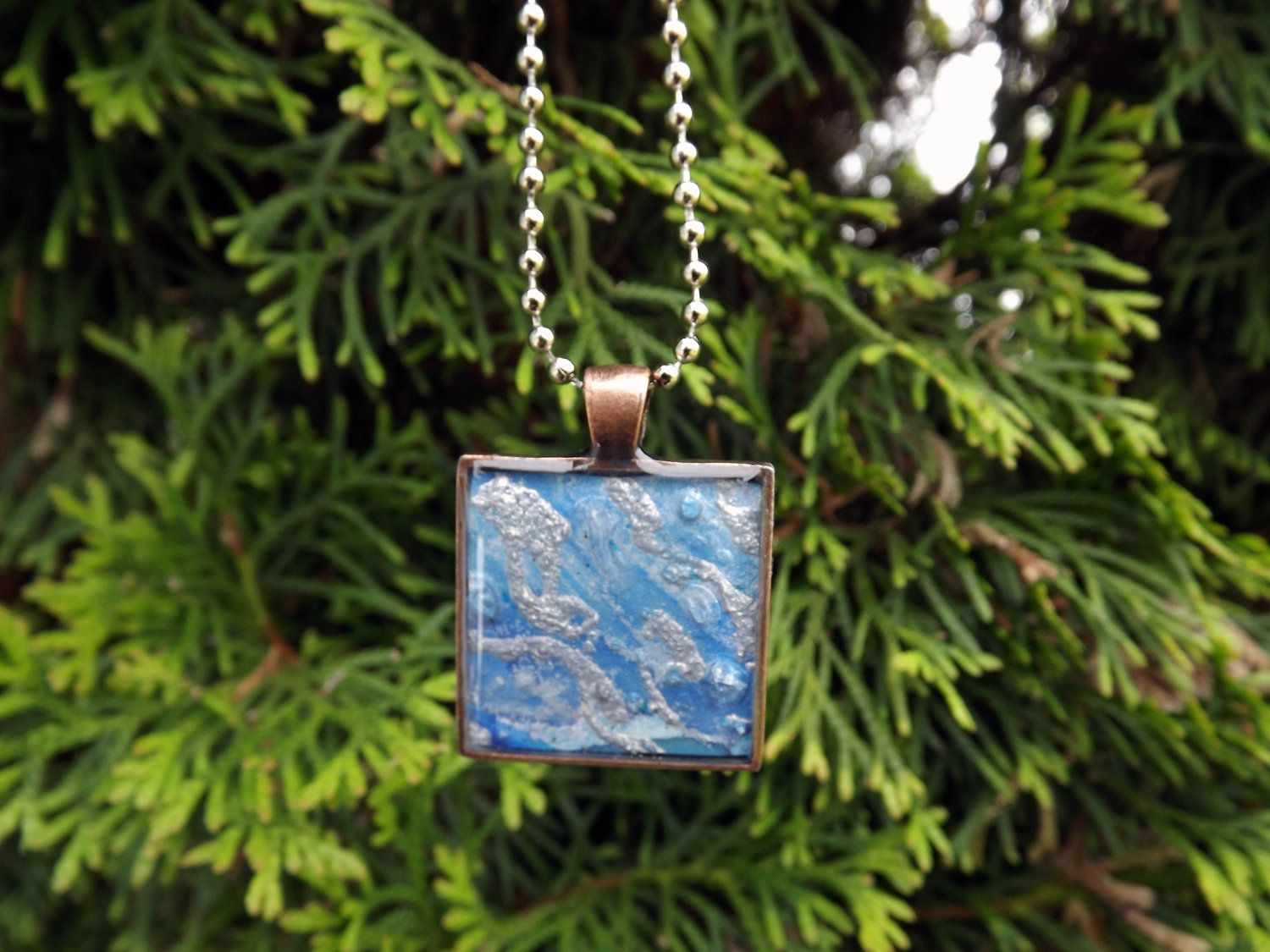 Elegant Blue and Silver abstract Jewelry Pendant necklace -Three Demensional with Resin - wearable art by Terripoppinscrafts. $12.00, via Etsy.