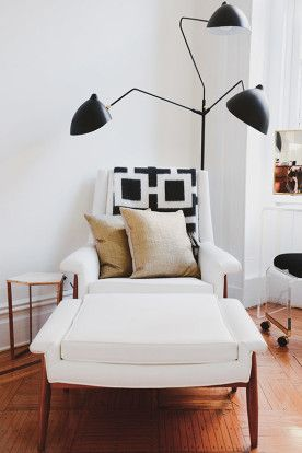 White lounge chair with stylish lamp
