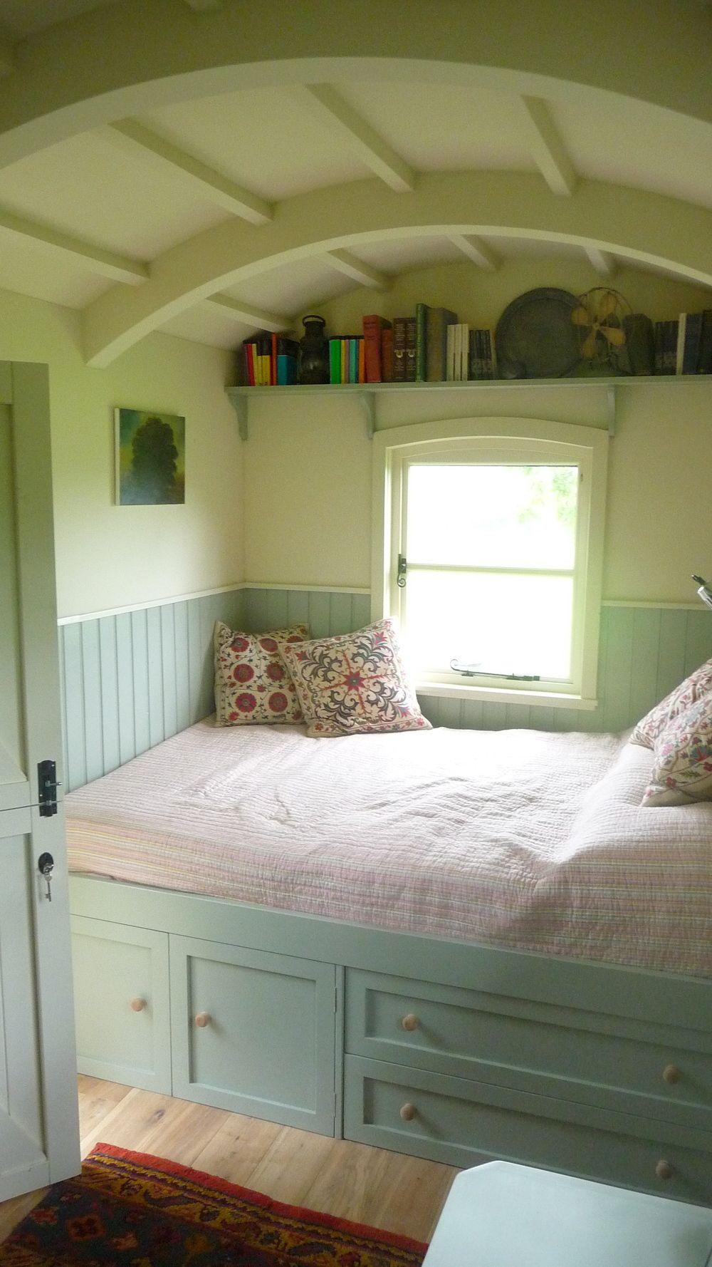 Bed under window  hawthorn hutsu shepherdus hut set in the dorset countryside