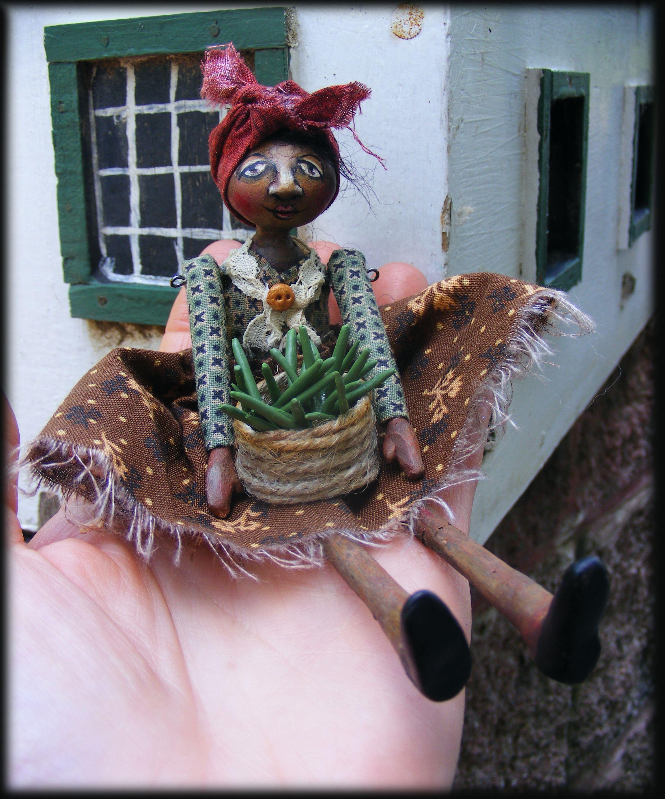 Folk Art miniature black mammy primitive doll, with green beans in her handmade basket.
