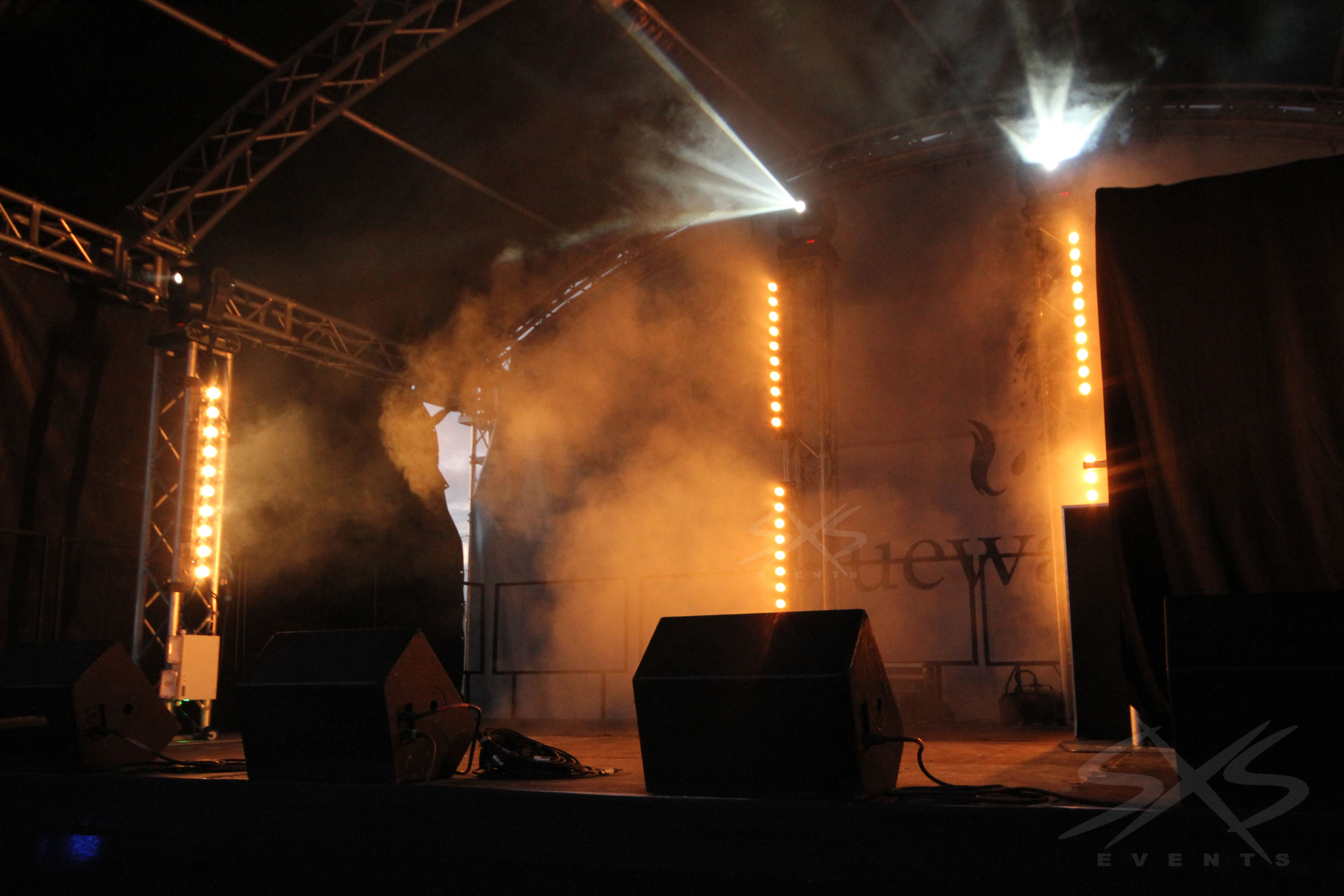 Stage lighting sunstrips and moving head beam lights with haze