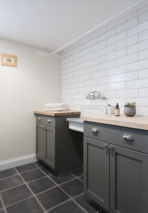 Gray Laundry Room Features An Accent Wall Clad In White Brick