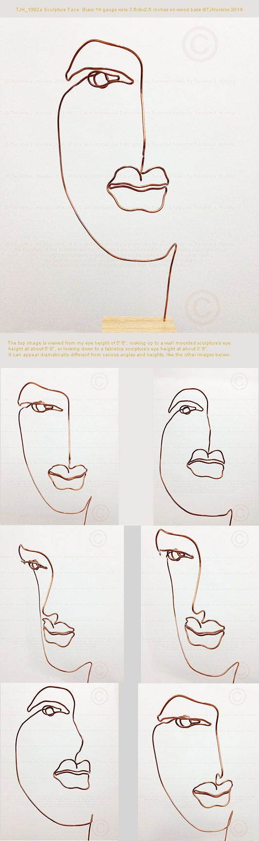 Wire line drawing metal sculpture of a face that is 4\