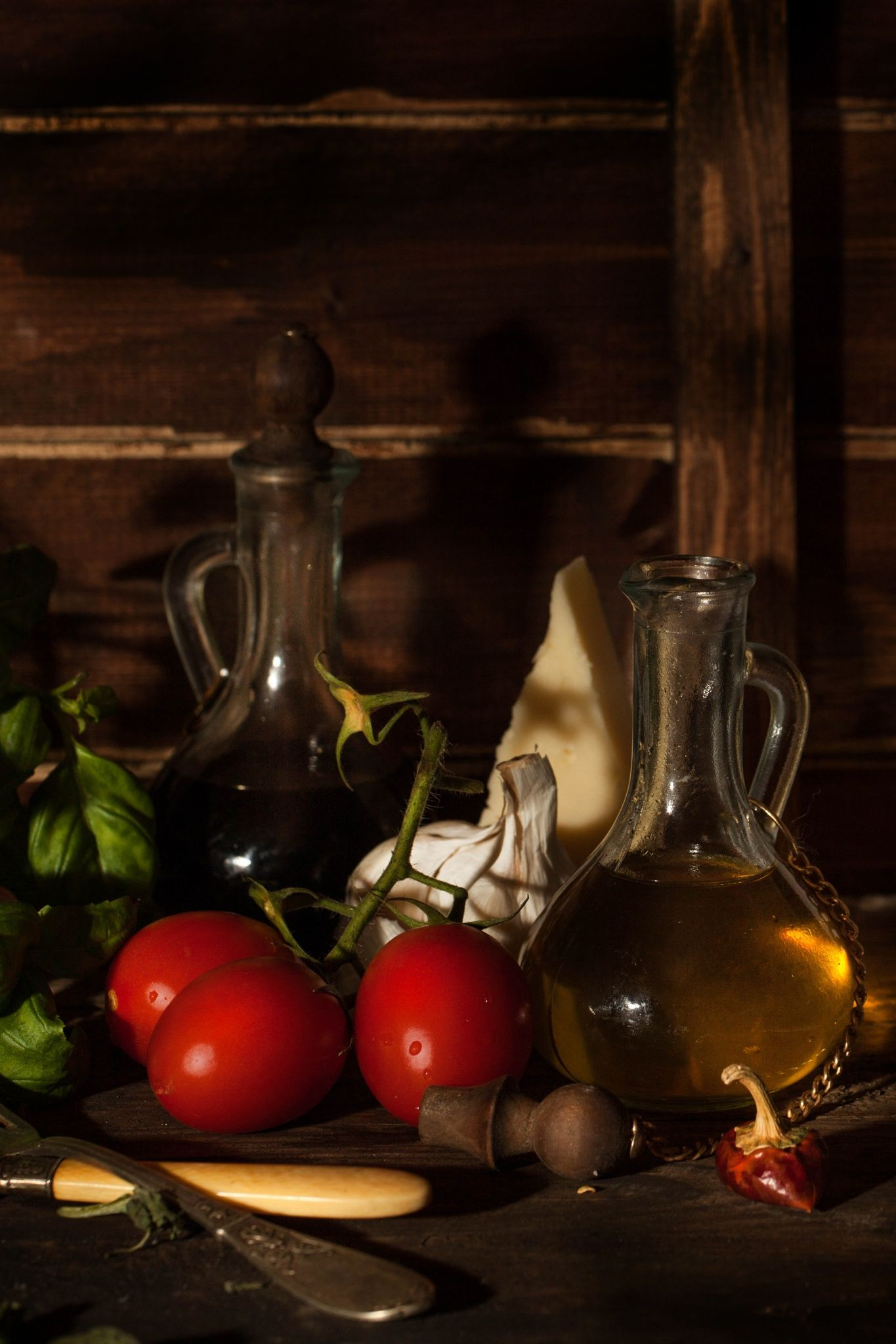 Rustic - Still life with olive oil, tomatoes and garlic ...