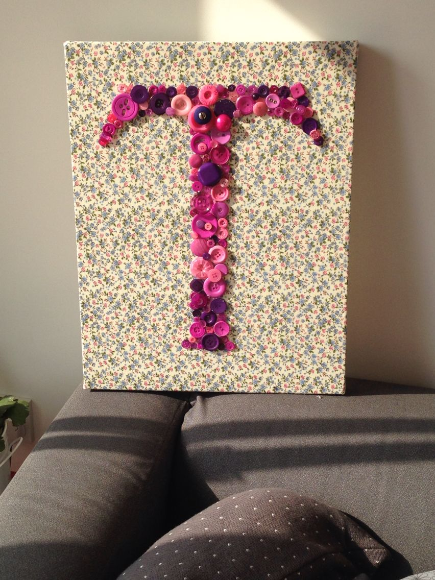 Buttons make up this letter on a material covered canvas!!
