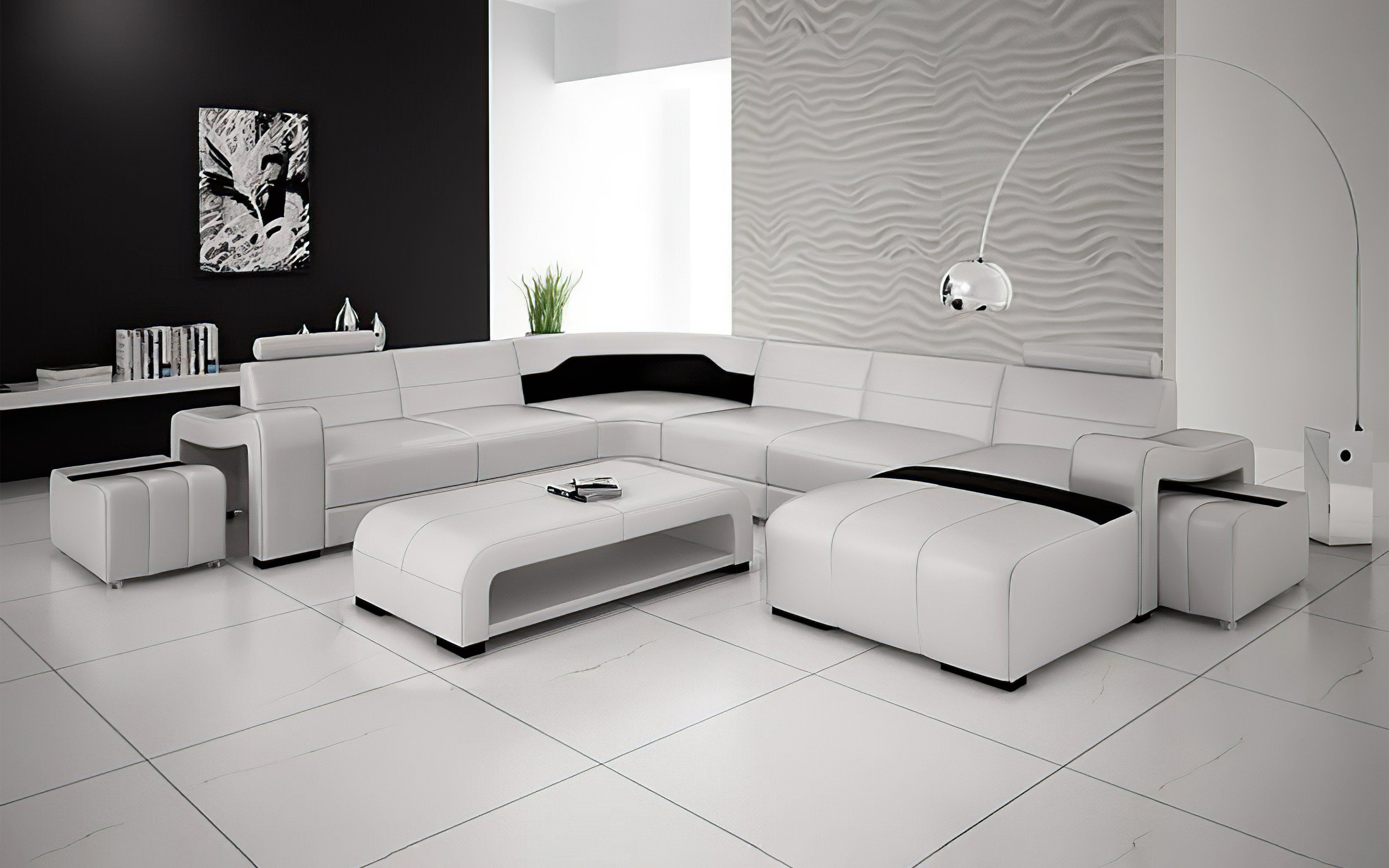 TABS Description Buying Modern Furniture In Las Vegas The Sunnydale Large Sectional with Ottomans is available in 10 different colors of genuine Italian or bonded leather. This sectional features hidden ottomans at both ends of the sectional, perfect for guests. A larger room or living room is a perfect fit for this sectional. Each top headrest is adjustable. The spacious chaise is perfect to lay down and rest after a busy day. This modern leather sectional is inviting and stylish, instantly mak