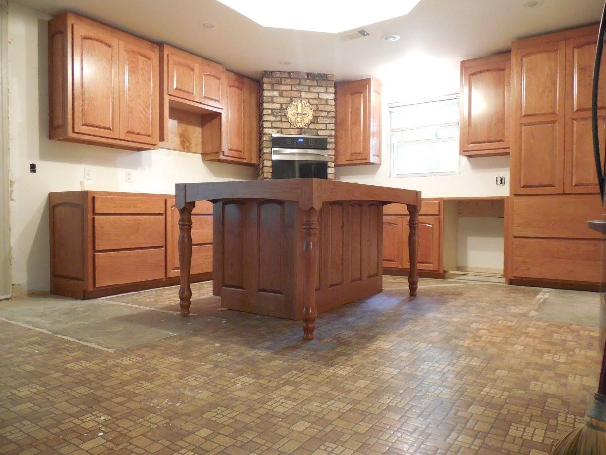 Cherry Cabinets Island With Built In Table Stained Finished Crown Shoe Moulding Still To Be Installed