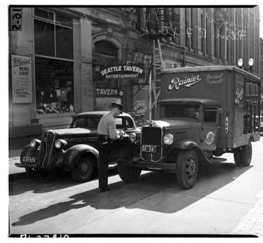 Patrolman citing a truck for double parking, September 1941 :: Museum of History and Industry