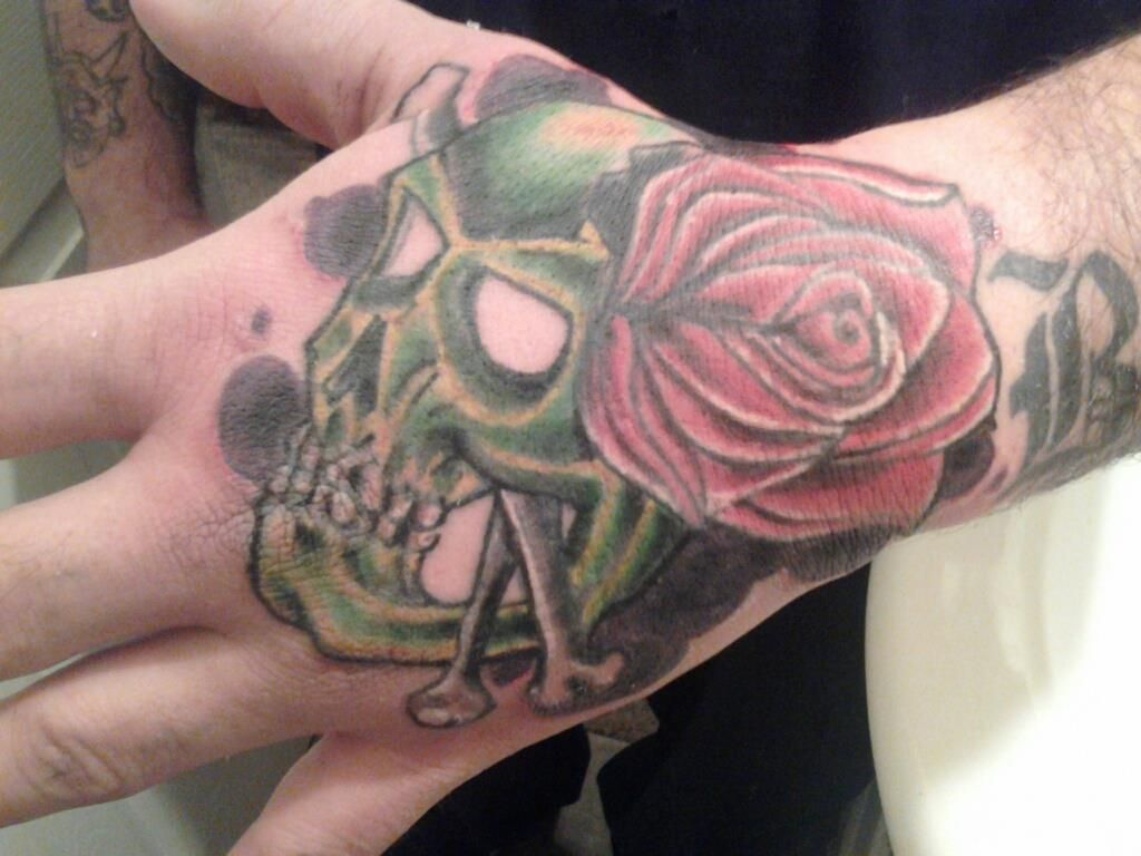 Route 66 tattoo picture at checkoutmyink com - Rose Skull Hand Tattoo
