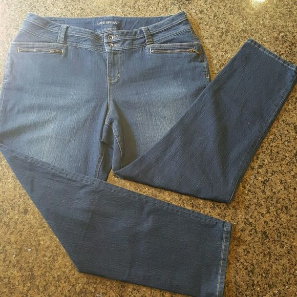 """Lane Bryant Zipper Cute pocket detail on these stretchy jeans.  Measurements:  Waist 20"""" Inseam 30"""" Outseam 42"""" Front Rise 11"""" Back Rise 18"""" Hips 46"""" Lane Bryant Jeans Straight Leg"""