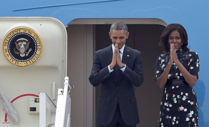 Pin for Later: It's Official: Michelle Obama Is the Most Stylish Jet-Setter Michelle and Barack Greeted Patrons as They Disembarked From Air Force One