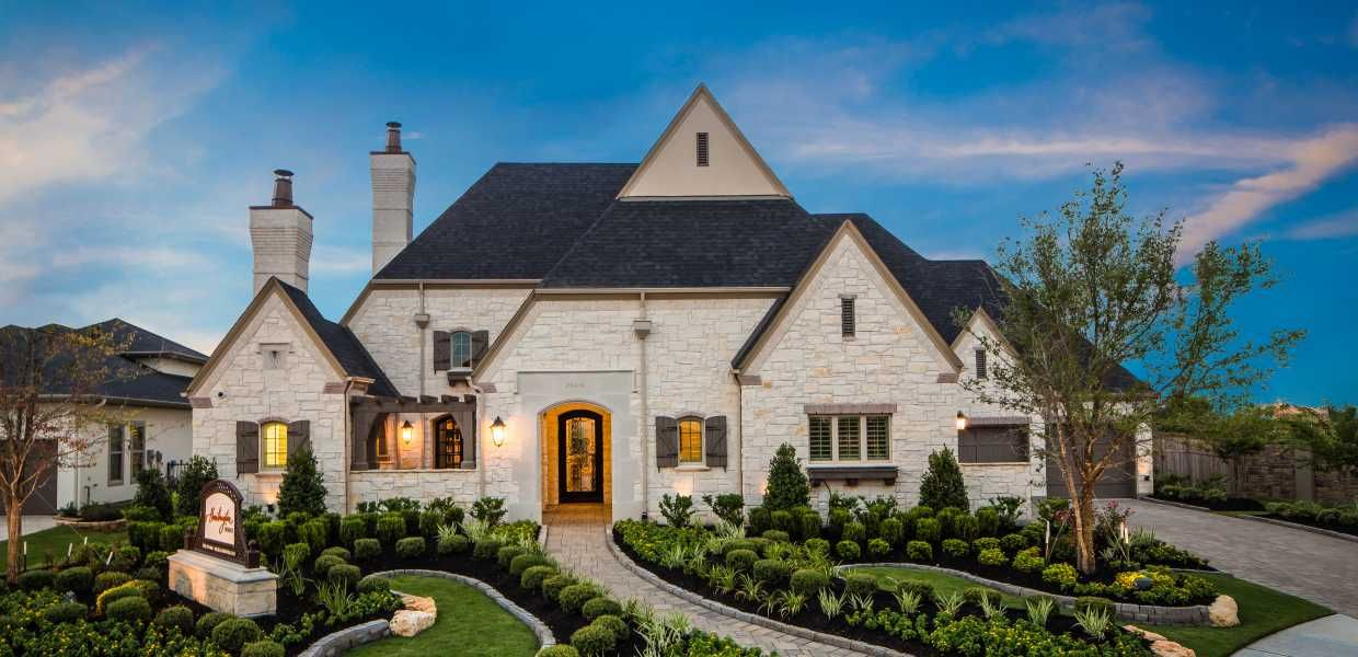 A luxury home designed by huntington homes at heron lake