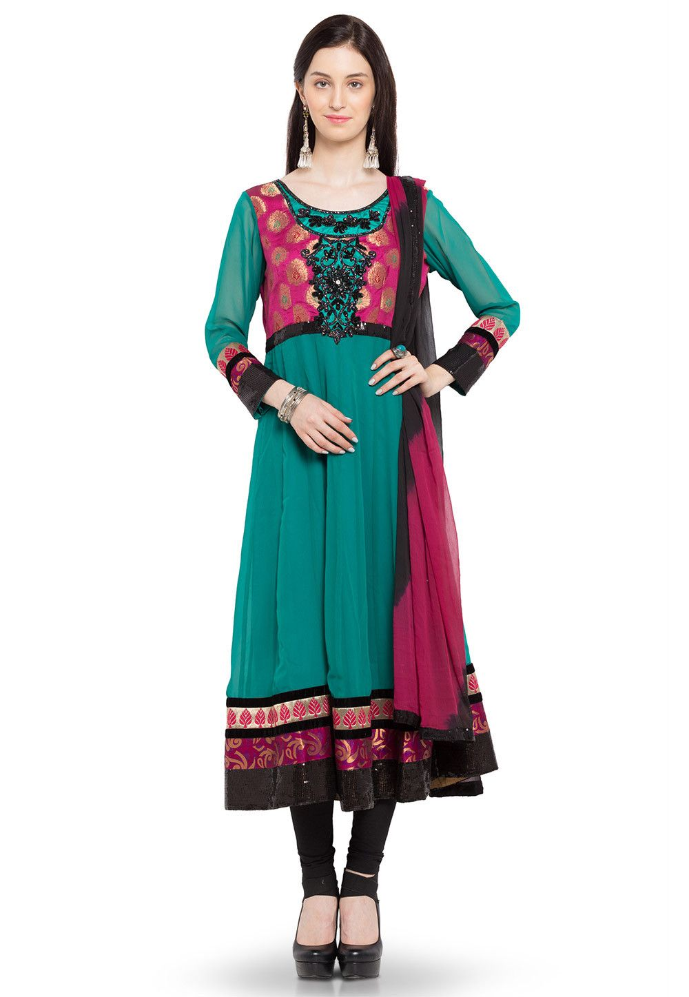 Magnificently detailed with Brocade Yoke and Cutdana, Sequins Embroidered Patch work Hemline (including sleeves hemline) highlighted with Patch border Faux Crepe lining Available with Faux Crepe Churidar in Black and Faux Chiffon Dupatta in Shaded Black and Fuchsia Readymade Suit