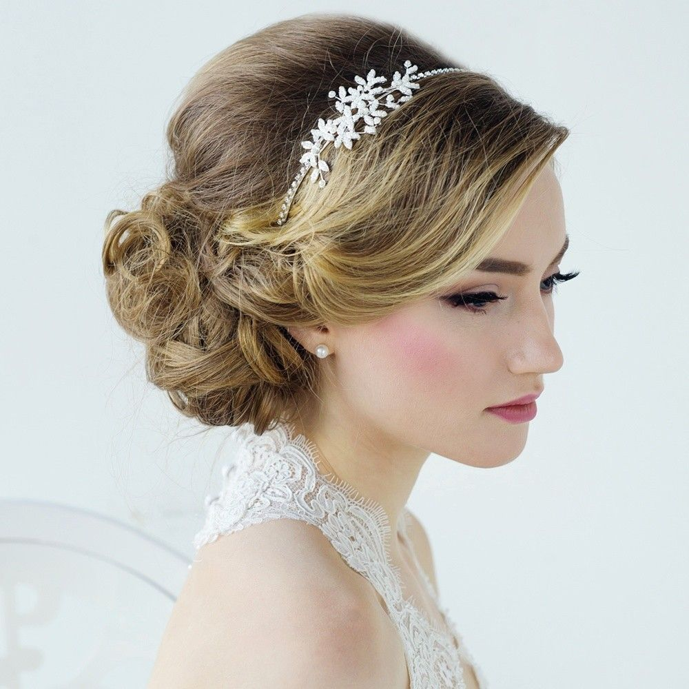 Bonham Pearl Wedding Side Tiara Headband - This very pretty pearl hairband is a side tiara design with diamante headband and pearl details. The pearls stand out beautifully against dark or light hair and create a soft vintage style.