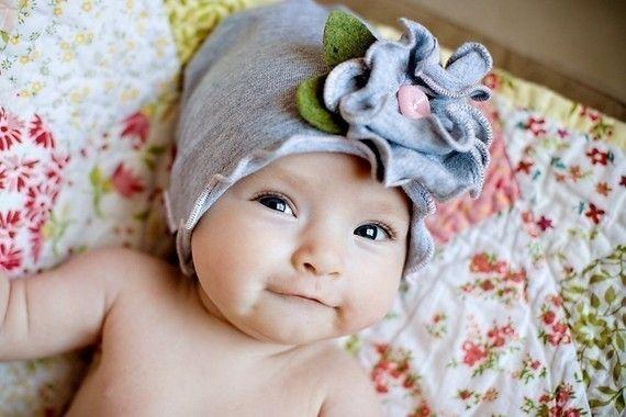 So cute... Sungars May flower beanie   http://www.etsy.com/listing/61457471/snugars-may-flower-spring-hat-beanie