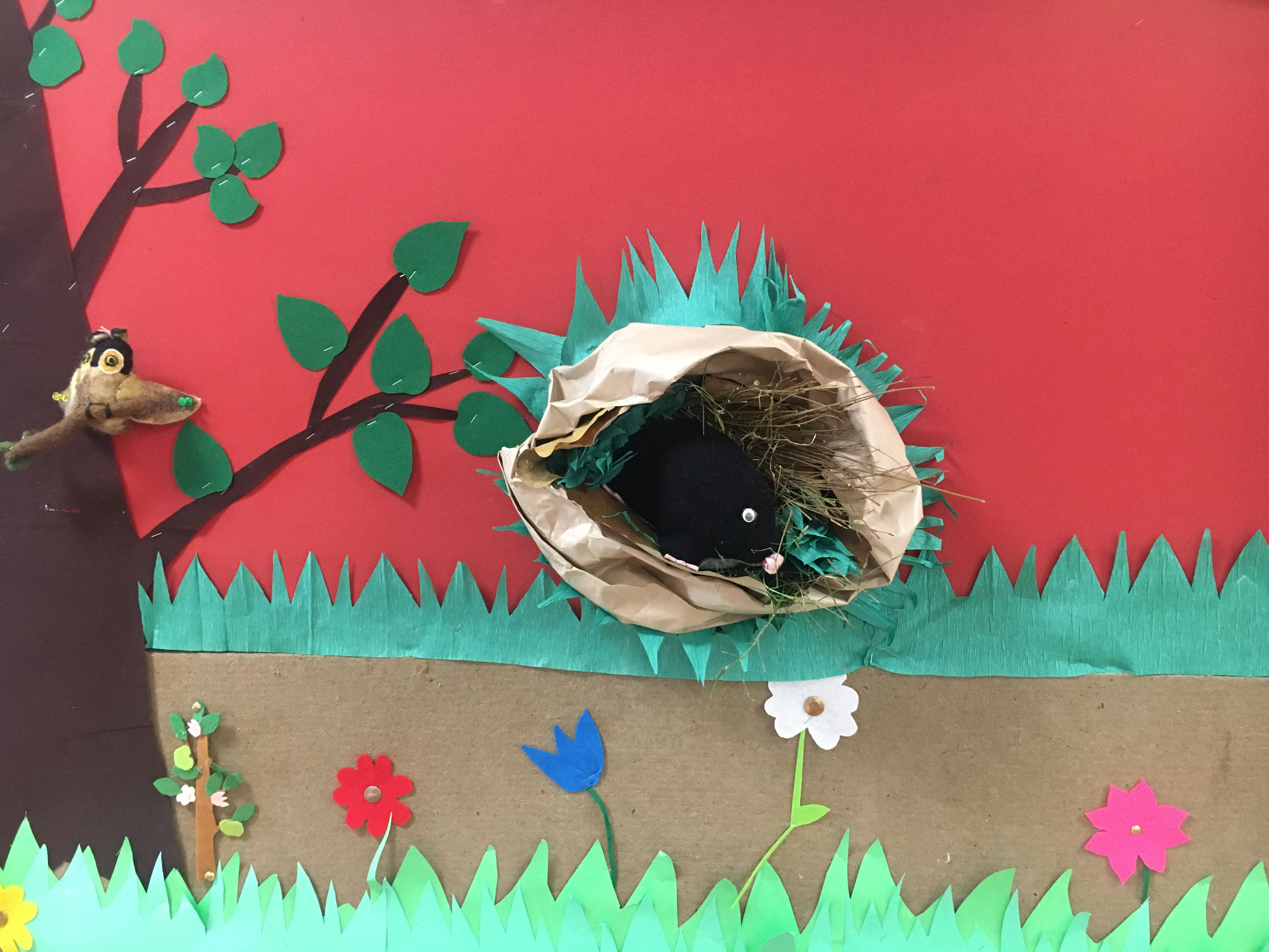 Class board for the story 'one mole digging a hole'