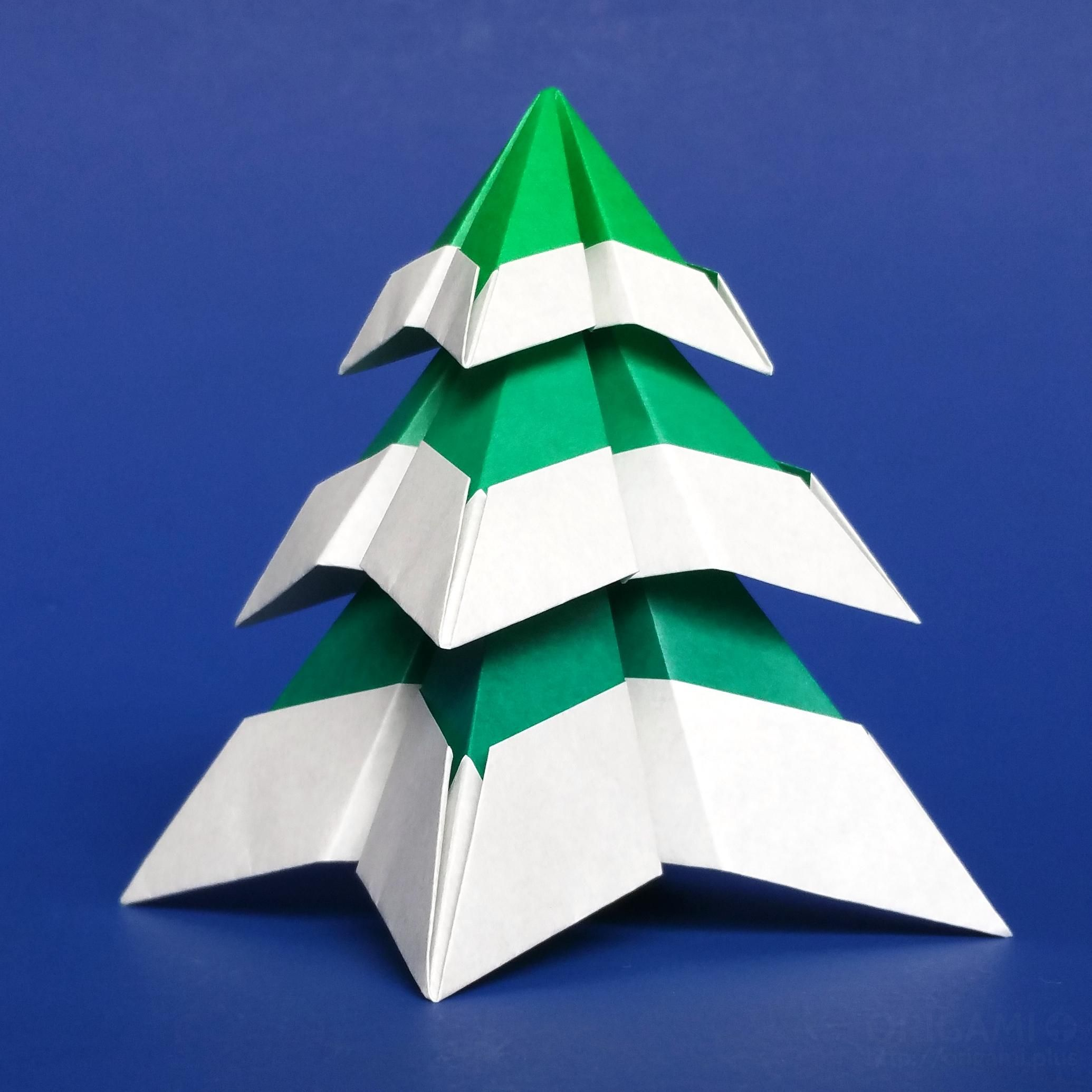 A snowy origami christmas tree i made with squares of paper no