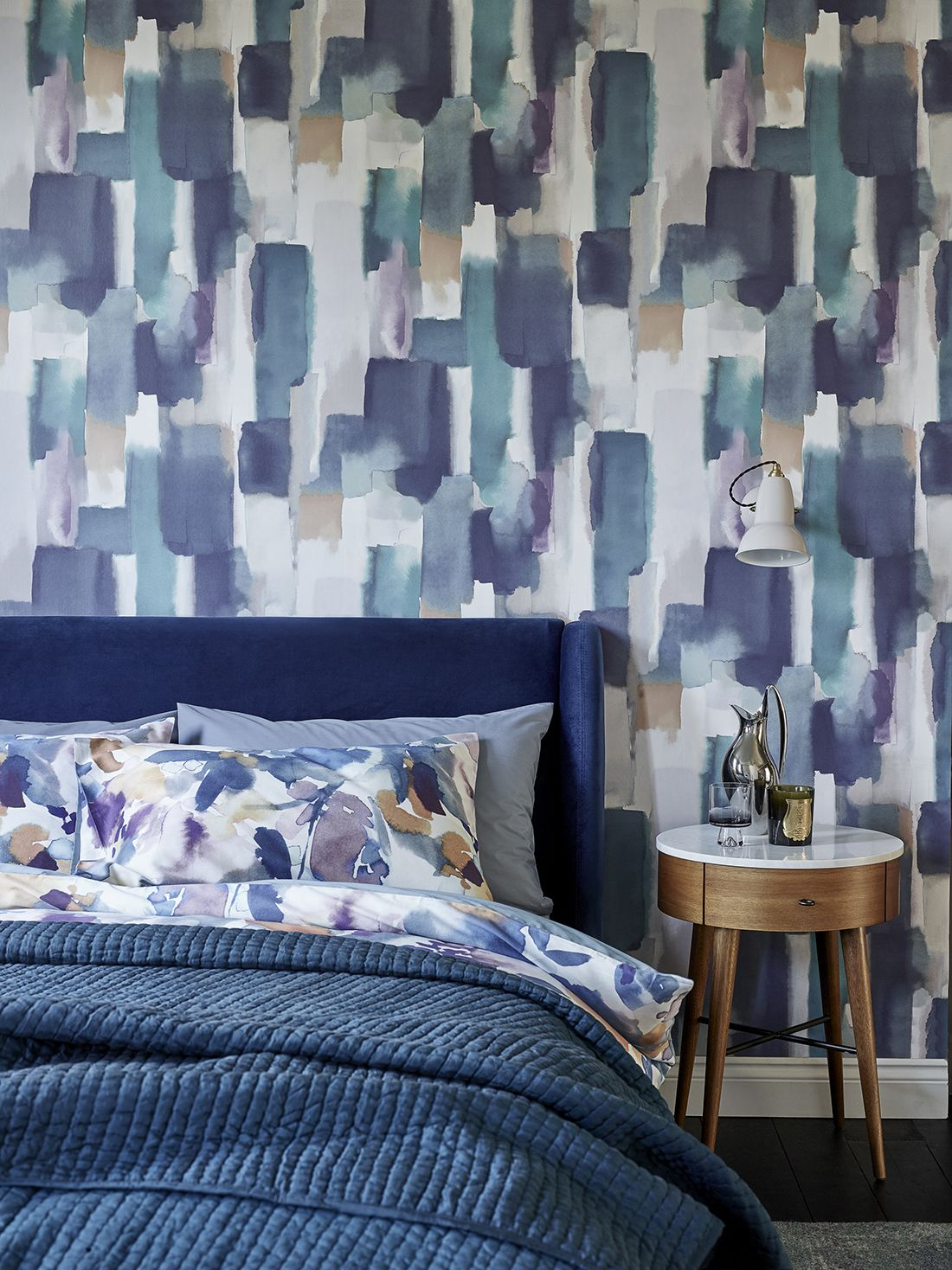 Sometimes, all a bedroom needs is a fresh sheet of wallpaper to