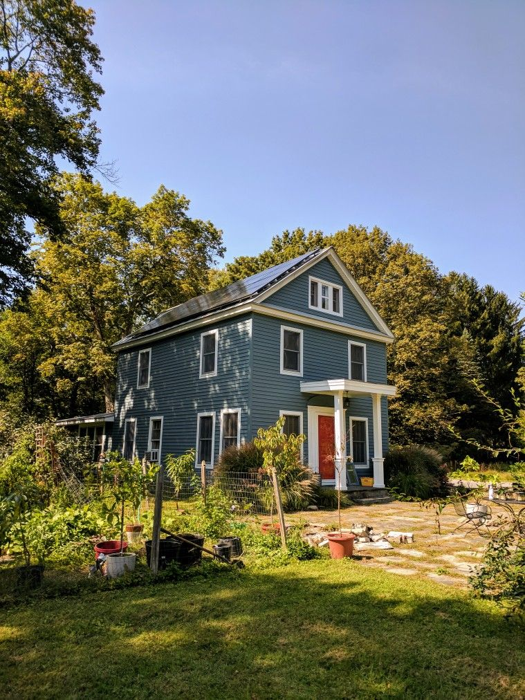 Best Dark Blue Gray Farmhouse With Gray Metal Roof Red Dutch 400 x 300