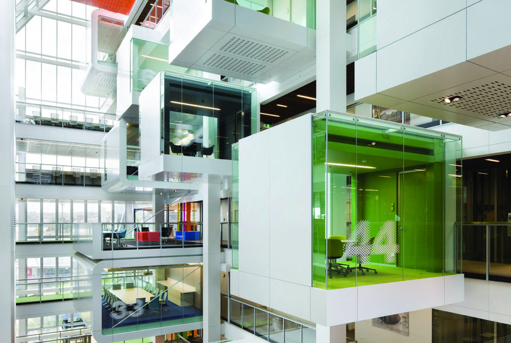An Open Ten Storey Atrium Featuring Floating Cantilevered Meeting Pods That Form A