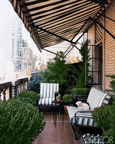 Great apartment balcony, black & white striped awning and