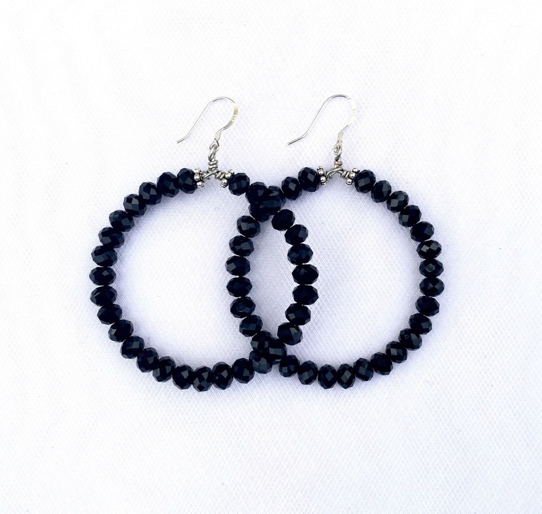 A personal favorite from my Etsy shop https://www.etsy.com/listing/465390534/black-crystal-beaded-hoop-earrings