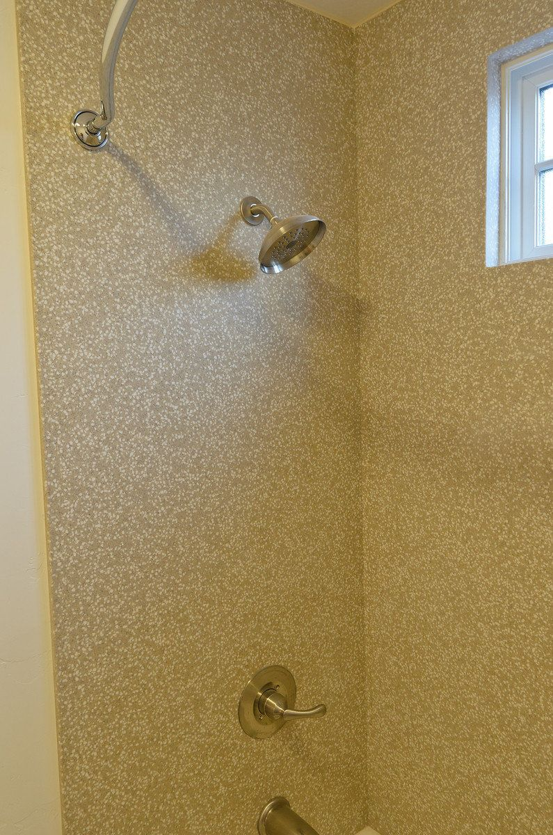 Corian solid surface shower walls eliminates grout and is for Solid glass shower doors