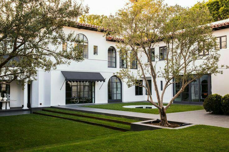 Mediterranean style house with green open garden.
