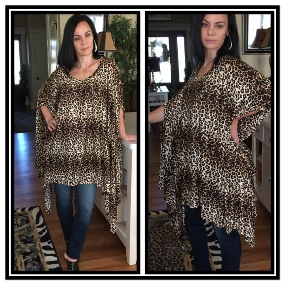 WILD CHILD TUNIC Let your animal instincts run wild, in this oversized leopard print kimono sleeve tunic top.  Throw on your leggings or tights, jeggings or jeans, maxi or mini, and you're set to start turning heads.  A soft 100% Rayon, length is 44 inches. Sizing is OS.  Wear it loose, or belt it for different looks; even tie the longer corners into knots.  So many decisions!!  No holds or trades; price is firm, unless bundled. Boutique Tops Tunics