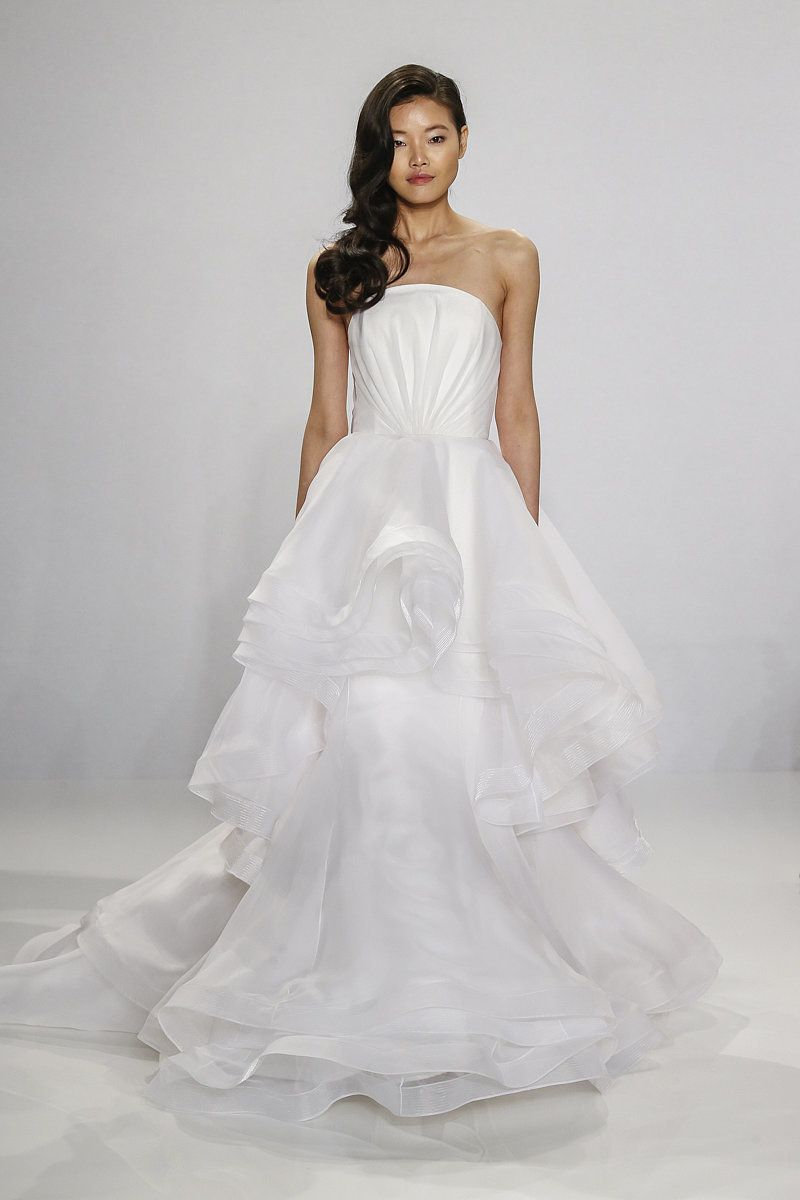 Cascading strapless overlay gown.