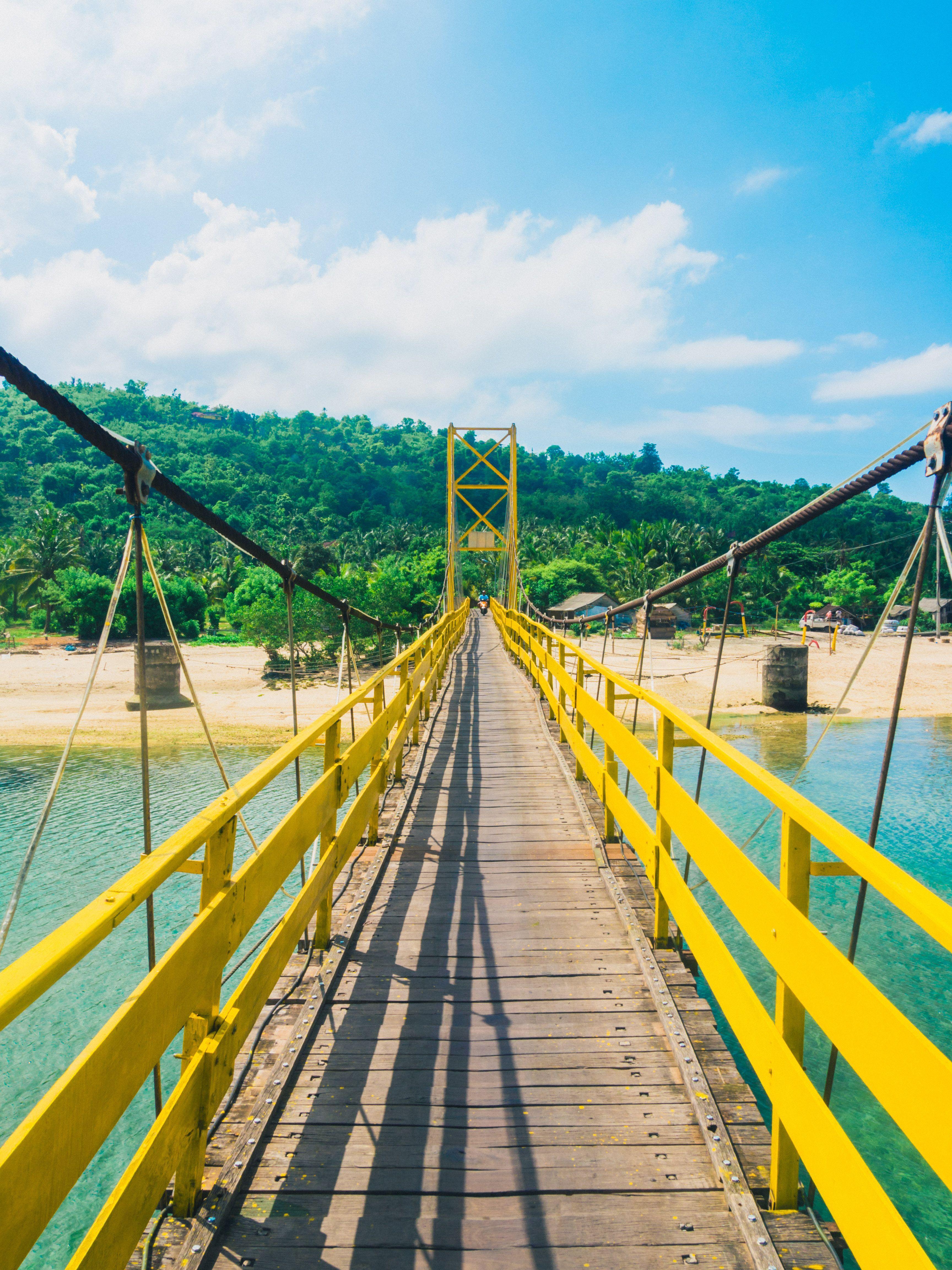 The yellow bridge connecting Nusa Lembongan & Nusa Ceningan, Indonesia. Just 30 min. off the coast of Bali!