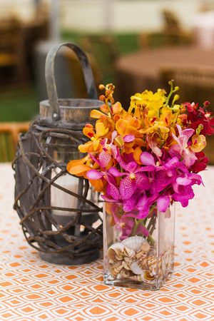 Rustic lantern and colorful orchids!