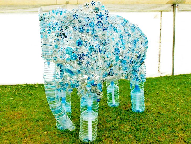 Hundreds of children build amazing elephant sculpture from for Things made from waste plastic bottles