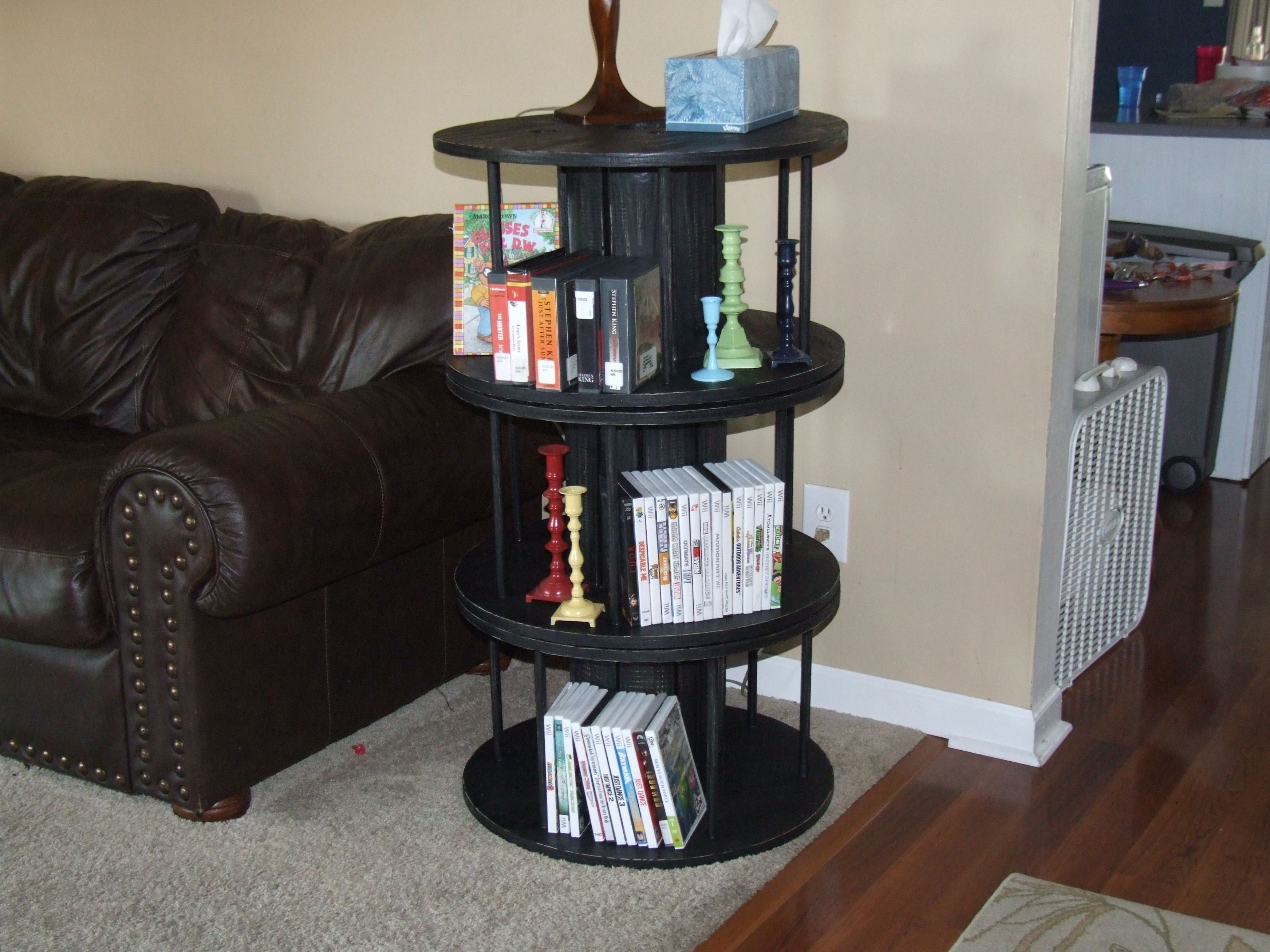 Small industrial wooden spools painted black and stacked for a three ...