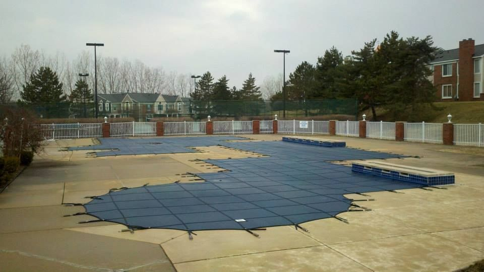 Rayner blue safety mesh commercial pool cover. Pool