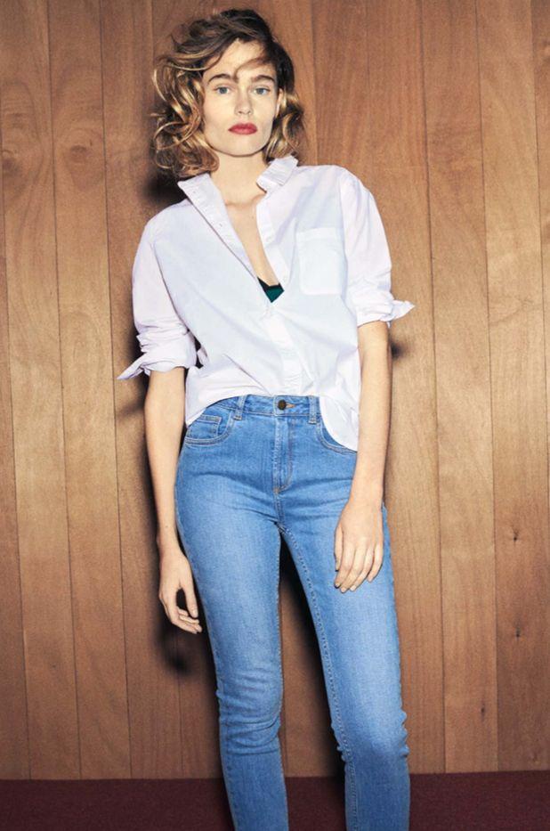 Light pink button-down shirt and high-waisted blue jeans