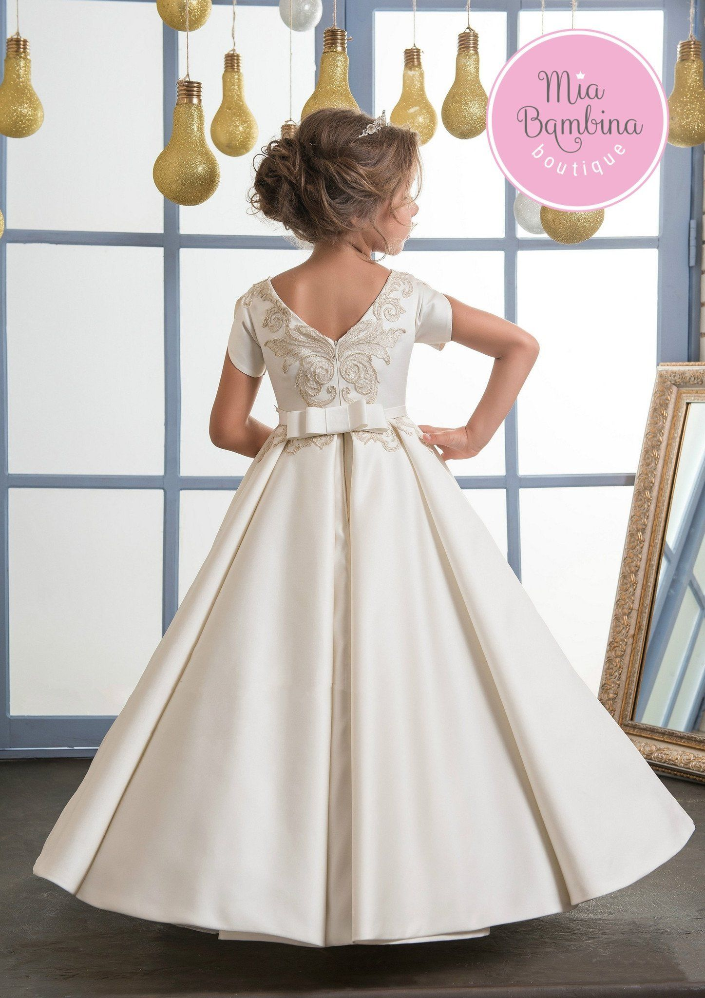 b226cd83ec ... of any flower girl. This A-line satin dress features a jewel neckline