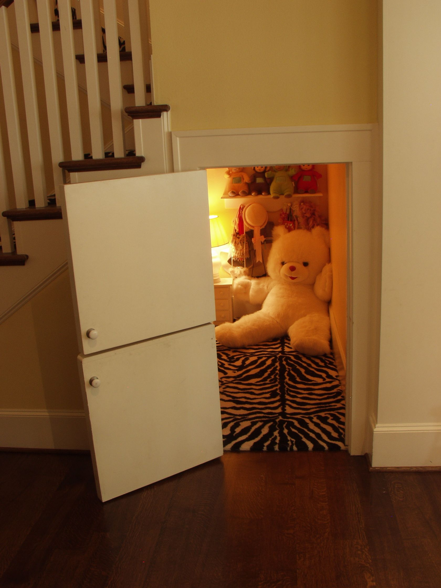 Every kid should have a secret hiding place under the stairs!